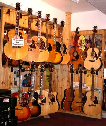 One small area of acoustic guitars within Frailers Vintage Guitar and Banjo Shop